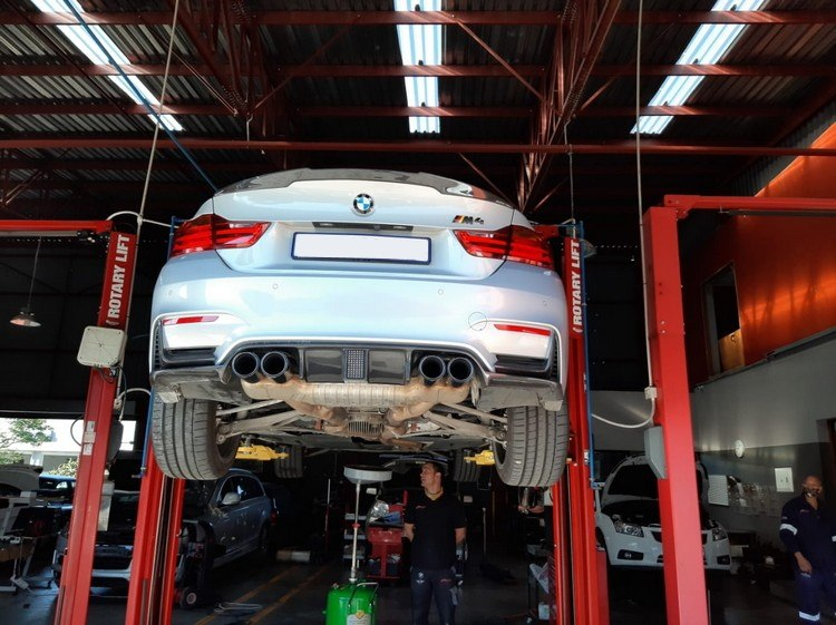 Draining the oil from this BMW M4 at GP Motor Works